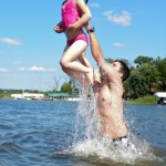 Dad and daughter having fun in the lake.
